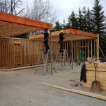 Workerrs installing second level floor trusses for and Edmonton construction project